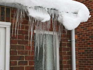 Icicles and snow: Icicles and snow on a suburban outhouse.
