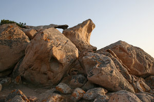 Coastal boulders: Pink granitic boulders on the coast of Sardinia.