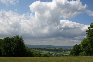 Dominating: Huge cumulus clouds over a village on the South Downs, West Sussex, England, in summer.