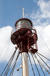 Lighthouse ship: The mast and light of a lighthouse ship in dock in Copenhagen, Denmark.