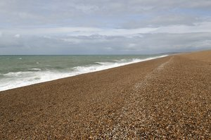 Shingle beach: The enormous shingle spit at Chesil Beach, England.