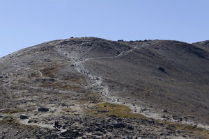 Bleak mountain trail: Walkers on a hard bare peak in the Rocky Mountains near Jasper, Canada.