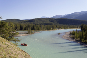 River rafting: Floating downriver on an inflatable raft in western Canada.