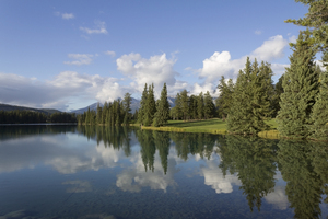 Clear calm lake: Lake Beauvert, Jasper, Canada, in evening light.