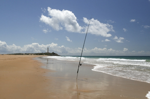 Beach fishing: A fishing rod on a beach in southern Spain.
