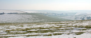 Cold winter landscape: Winter on the hills of the South Downs, West Sussex, England. Three shot photomerge.