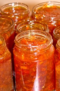 Freshly made marmalade: Freshly made marmalade solidifying in its jars.
