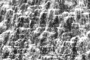 Dam cascade B/W: B/W of water cascading over aerator blocks on a dam wall in Wales.