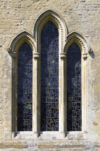 Church window: Tripartite window of a rural church in Surrey, England.