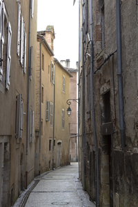 Alley: An alley in an old town in the Dordogne, France.
