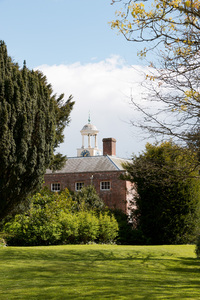 Old house with clocktower: An old manor house with a traditional clocktower in England.