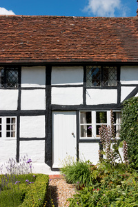 Old cottage: An old timber and whitewash cottage in West Sussex, England.