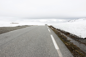 Snow road: A road over a high snowy plateau in Norway.