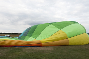 Inflating a hot air balloon: Inflating a hot air balloon at an airfield in England.