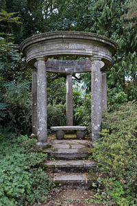 Garden temple folly: A garden folly in the style of an old Greek temple in Kent, England.