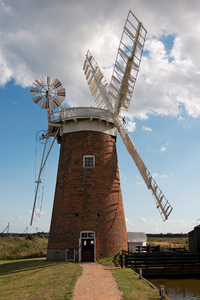 Old windmill: Horsey Wind Pump, an old water-pumping windmill in Norfolk, England. Photography of this National Trust site was freely permitted.