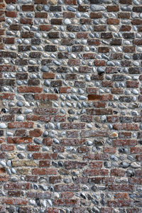 Old wall background: An old brick and flint wall in Norfolk, England.