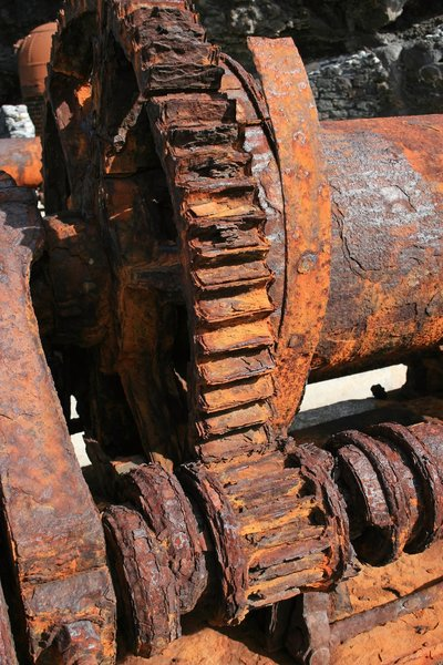 Corroded winch: A corroded fishing winch on a disused industrial wharf in Madeira