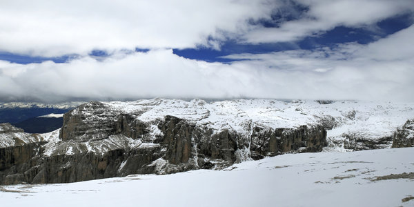 Snowy plateau: A snowy plateau vanishing into the clouds high in the Dolomites, Italy.