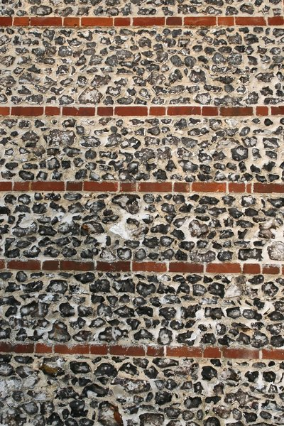 Flint and brick wall: An old flint and brick wall on a cottage in Wiltshire, England.