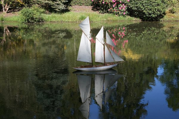 Model yacht: A remote controlled model yacht on a lake in West Sussex, England.
