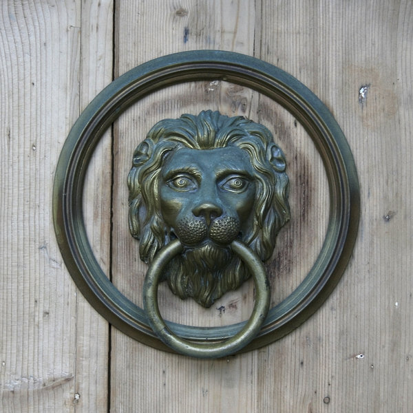 Door knocker: An old brass door knocker in Austria.