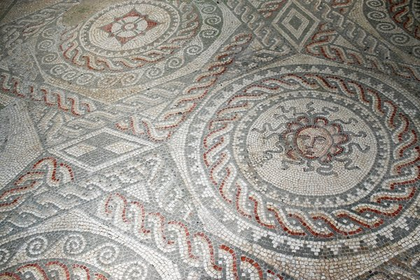 Ancient Roman mosaic floor: Genuine ancient Roman mosaic floor at Bignor, West Sussex, England. Photography at this site was freely permitted.