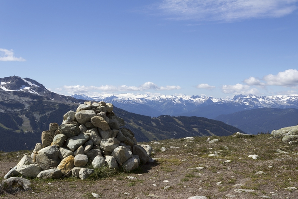 Mountain waymarker: A cairn of stones as a waymarker for a hiking trail in the Coast Mountains, Canada.