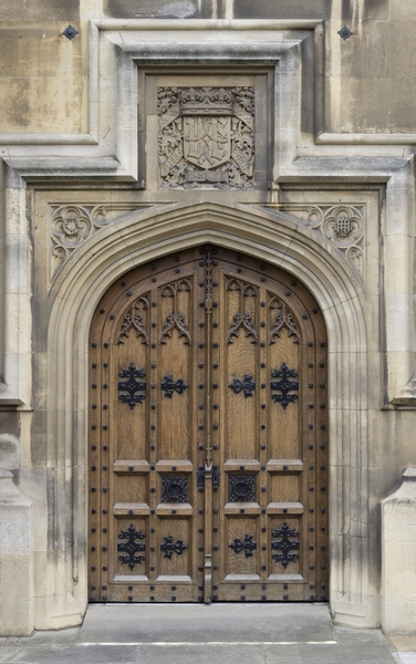 Door into Parliament: An old door into the Houses of Parliament, Westminster, London, England.