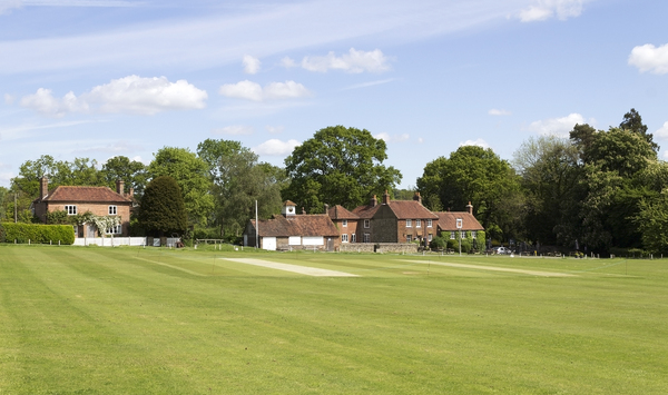 Village green: A village green with cricket pitch in West Sussex, England.