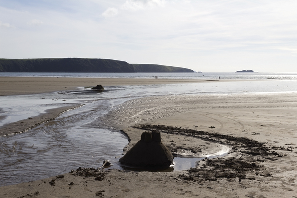 Beach with sandcastle: A beach in Pembrokeshire, Wales, in evening light.
