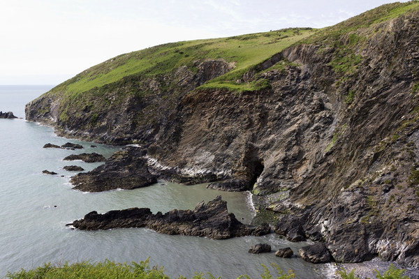 Coastline with cave: A cave on the coast of Pembrokeshire, Wales.