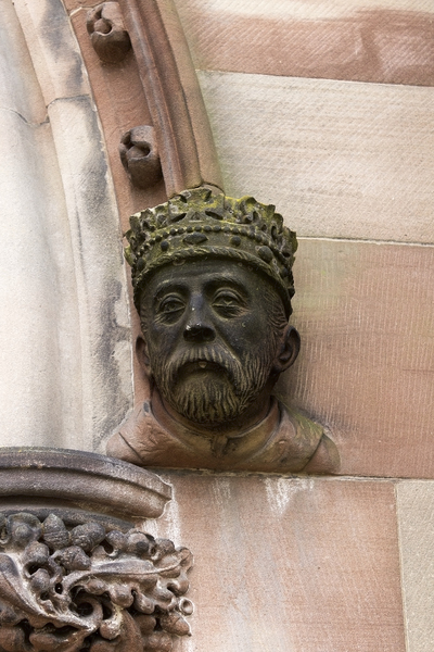 Monarch's head: Bust of a monarch at the base of a doorway arch into Hereford cathedral, Wales. Photography of the publicly accessible parts of this building was freely permitted.