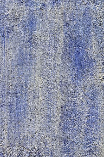 Blue wall texture: Rough mortar with a blue paint wash on an old wall in Catalunya, Spain.