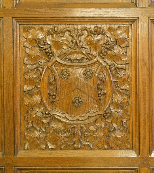 Carved wooden panel: An old carved wooden wall panel in the Supreme Court, London, UK. Photographed during the annual Open House London weekend, during which photography of selected areas is freely permitted.