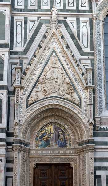 Florence Cathedral: An ornamental door arch at the Cattedrale di Santa Maria del Fiore (aka Il Duomo di Firenze), Florence, Italy. Photography of the exterior of this site was freely permitted.