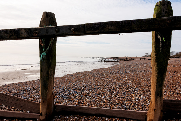 Beach groynes: Groynes on a beach in Sussex, England, in winter.