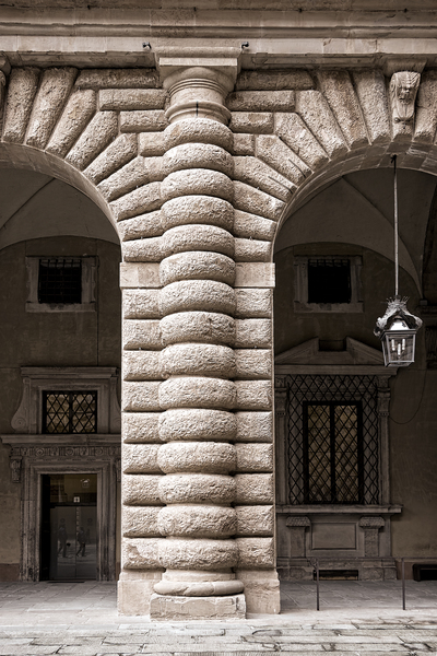 Italian architecture: A pillar of a large colonnade in the Medici palace, Florence, Italy. Photography in this area was freely permitted.