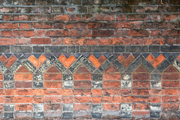 Patterned wall background: An old patterned brick wall in Norfolk, England.