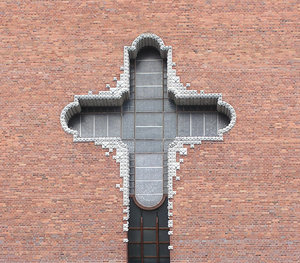 Cross in the church's wall: A huge cross in the church's wall. Warsaw, Poland.