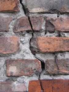 Crack in the wall: A crack in the brick wall.