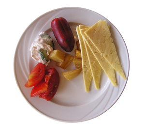 Tasty plate: Tasty plate with some cheese and  vegetables.