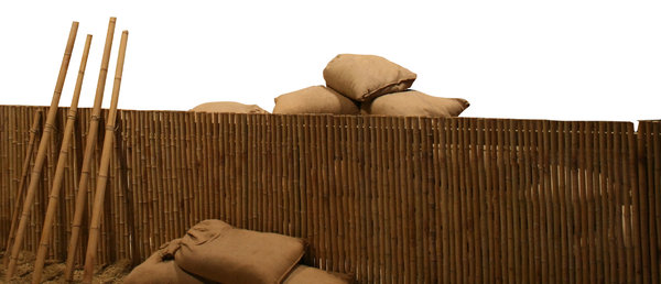 Bamboo fence: Bamboo fence and the bags of sand