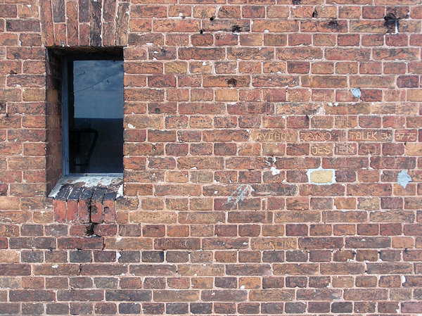 The brick wall: A wall with the window.