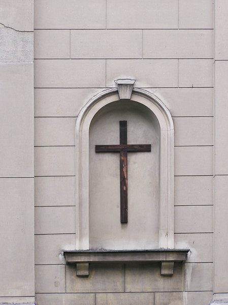 A cross: A cross in something that was a window before. Warsaw, Poland (Praga)