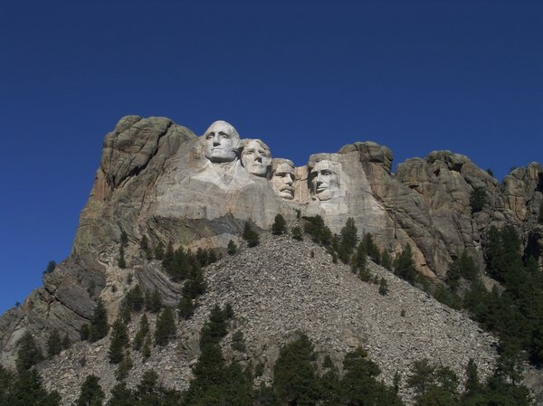 Faces of America - Mt Rushmore: Four Presidents of the United States forever carved into granite on the side of the mountain.  Mount Rushmore National Monument, South Dakota.