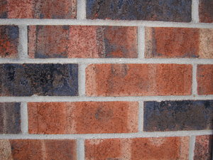 brick wall outdoor: closeup of brick and mortar wall