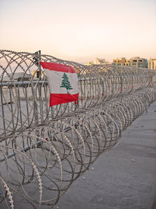 Nation building: Beirut city centre. This line of barbed wire was put in place before February 14 to keep the politically opposed crowds apart on that day of demonstrations. This is a sad picture as it represents the transformation of our city centre into an arena of poli