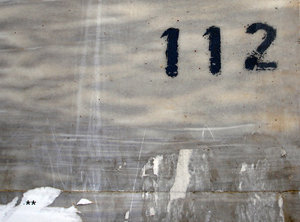 Number 112: A house number on a wall on a street in Beirut