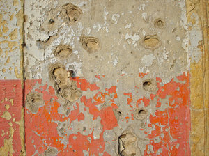 Weathered: A wall that bears the scars of the civil war and time.